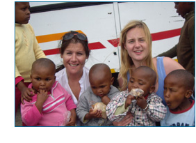Susanna Holden and Aoife McSweeney in Lesotho with children from the orphanage